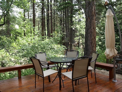 Start your day with a cup of coffee on this sunny deck above a year-round creek.