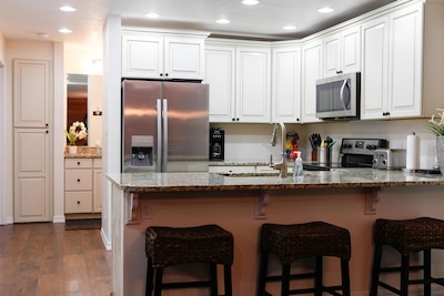 Beautifully renovated kitchen with granite counter tops and stainless appliances