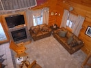 Living room with new furniture and gas fireplace.  Queen sofa sleeper