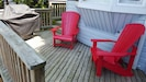 BBQ and chairs to lounge in on deck attached to main cottage.