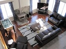 """Living Room with foosball table, wood stove and 55"""" LED"""
