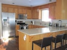Kitchen with all new stainless steel appliances and quartz countertop