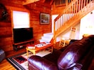 Living Room's 50' HDTV with 200+ channels, Leather Sleeper Sofa & Wood Fireplace