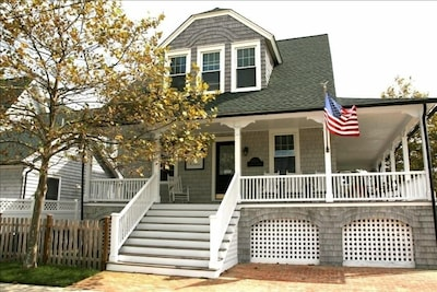 Wonderful wrap around porch sets the mood for this classic cedar single family h
