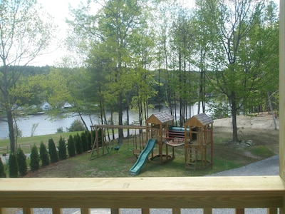 Picture taken from the 10 BR house showing the swingset/clubhouse and lake