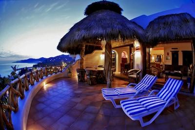 Sunset on the top patio of Casa Sofia, with panoramic views of Sayulita bay.