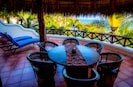 Dine alfresco under our huge thatched palapa roof on the patio.