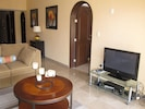 living area, flat screen TV with Cable, DVD player and speakers to hook up an iPod or your stero.