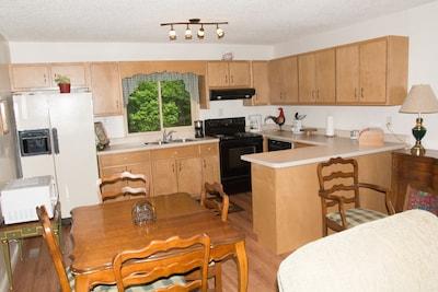 Full kitchen area with dishwasher.