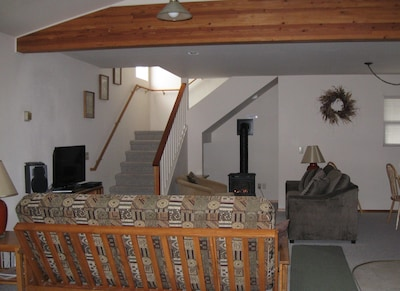 Living room with gas fireplace, full size sleeper sofa & full futon