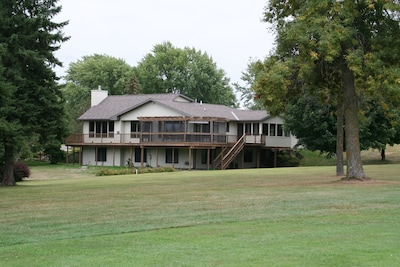 Wrap-around deck with screened patio overlooking back yard and golf course.