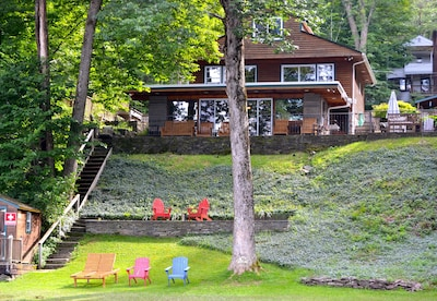 View of the cottage from the lakefront. Notice all the windows! Beautiful views.