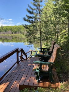 Peaceful view of the loons and eagles from new swivel glider chairs.