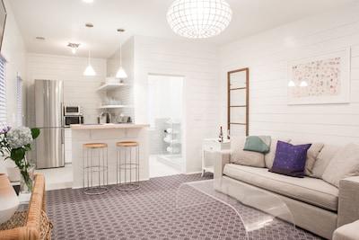 Open Floor Plan with kitchen, bar, bathroom and den.
