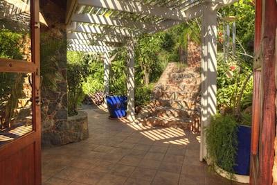 Descend the Stone Steps through Andante's Gardens to the Entrance
