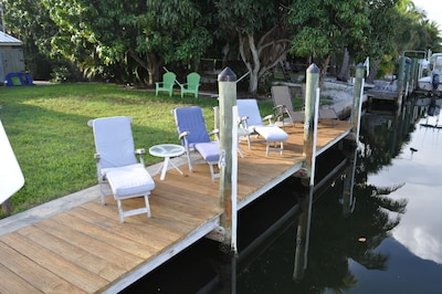 Grab a chair by the dock or under the shade of the mango trees