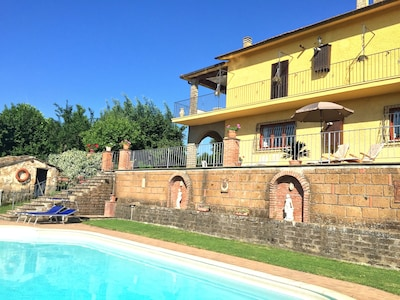 view across pool to sun terrace and villa.