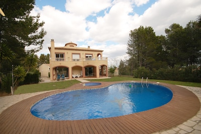 Rear garden and pool area