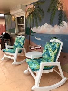 Relaxing poolside cookout area