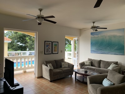 Living space opens to pool deck.