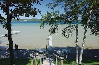 Steps leading to the dock and beach area with shallow swimming and great views