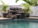 Soothing sounds of our Lava Rock Waterfall at pool edge