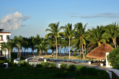 Beautiful beach /pool & grounds overview from your private balcony