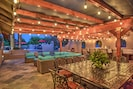 Huge Outdoor Covered Patio with hanging lights and lot's of patio furniture.