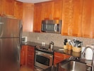 Brand new kitchen with granite countertops and stainless steel appliances!
