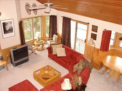 View of Living Room Area from Loft with Large Screen TV