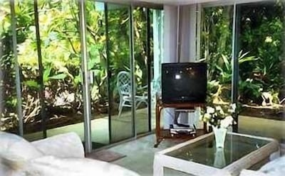 Living Room with Tropical Garden Views to West and North. Adds Hawaii Feeling