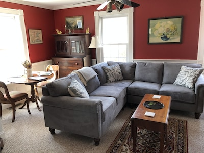 Cozy living area with wide-screen smart tv.