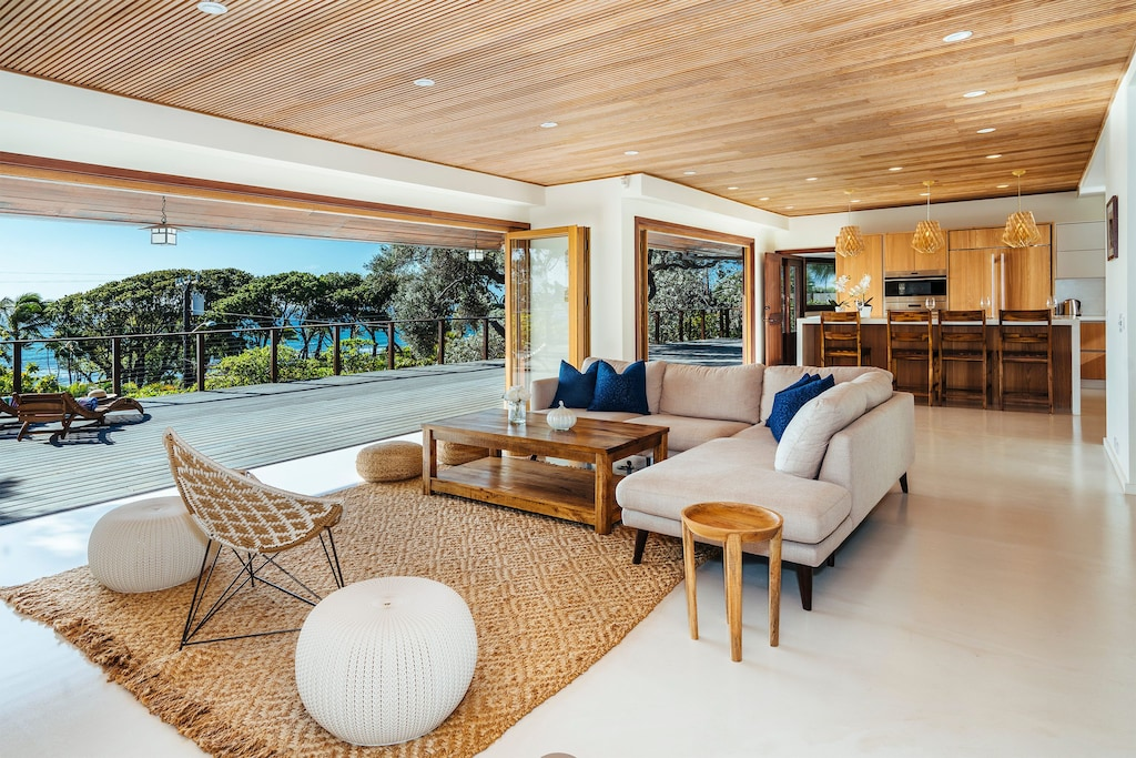 Image of an open-air living room in a villa in Hawaii, perfect for multi-generational travel.