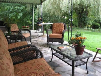 The patio overlooking the Holston River invites you to relax.