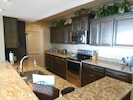 Updated Kitchen with New cabinets, Stainless appliances, and Granite countertops