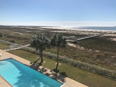 Great view from condo of beach and one of two pools. I pool is heated in winter.