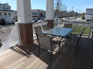 Large porch for morning coffee or afternoon drinks, great for people watching