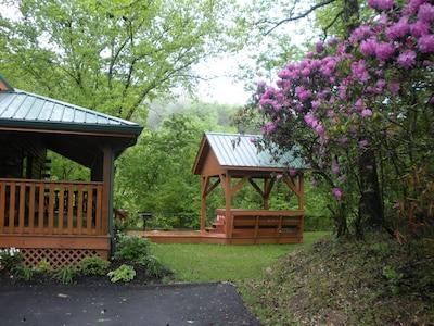 Beautiful side yard with gazebo and large hot tub