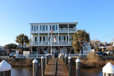 Boat slip and dock with fish cleaning station and access to private island.
