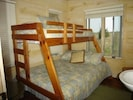Bedroom with bunk bed and sink.