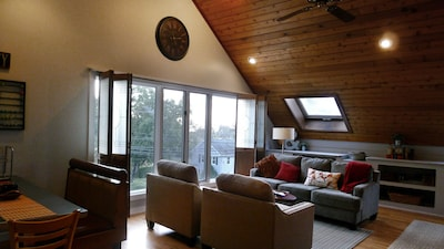 High ceilings and picture window with view are dramatic in the living area.