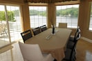 Dining room overlooking the lake, seats 8 and with a leaf seats 10