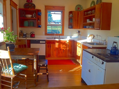 Large Kitchen, cherry cabinets, afternoon sun.