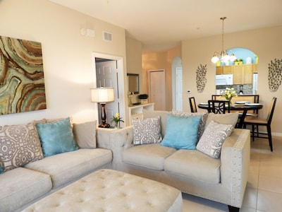 """Grandview LR-DR area.  Comfortable seating for 6+, 55"""" HD TV + pool view seating"""