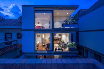 Twilight from social balcony toward the apartment: MBR/deck, living room/balcony