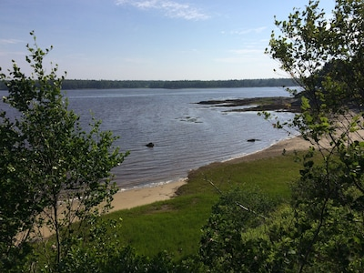 The sand beach, high tide, seen from the trail out to the end of the Point.