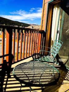 Sit in the sun and enjoy the slopeside balcony.