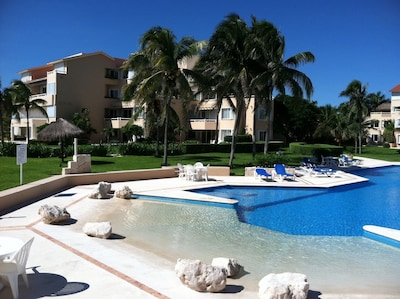 Part of the huge pool. VDM C 105 and 205 are seen  between the palms.