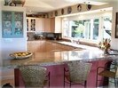Sunny granite kitchen open to the living room and dining area with views