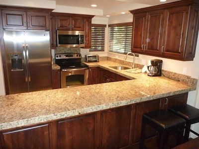 Deluxe Kitchen with all new stainless appliances, granite counters, slate floor